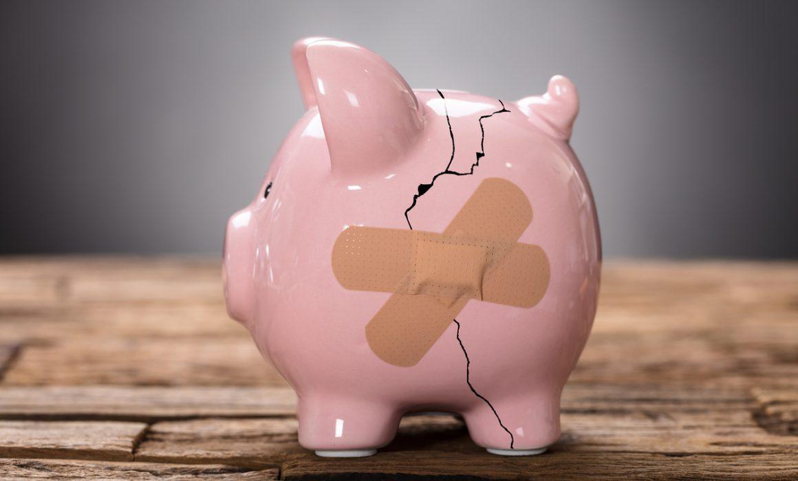 Broken Pink Piggybank With Bandage