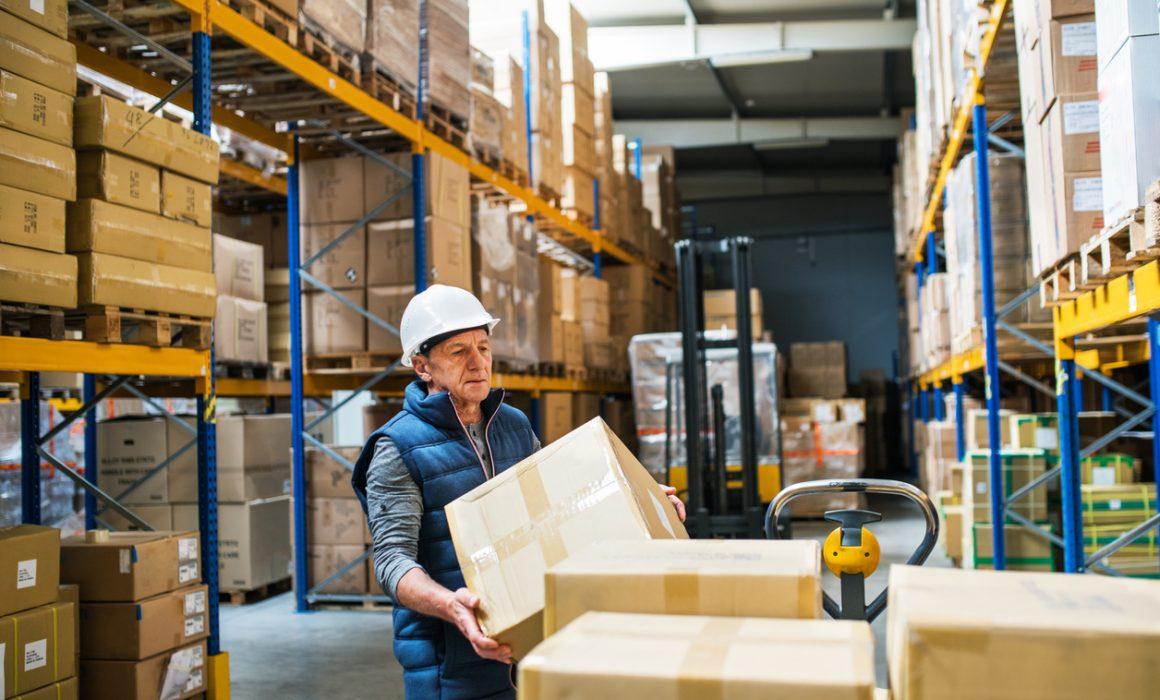 Senior male warehouse worker